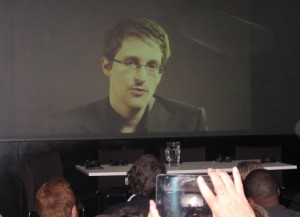 Whistleblower Edward Snowden, appearing by video link